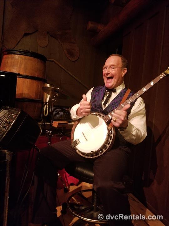 Disney vaudeville style show guitarist
