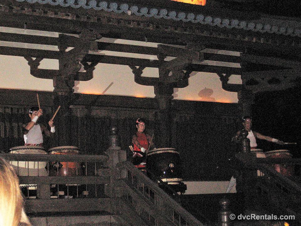3 Taiko drummers at Japan's pavilion Matsuriza ensemble