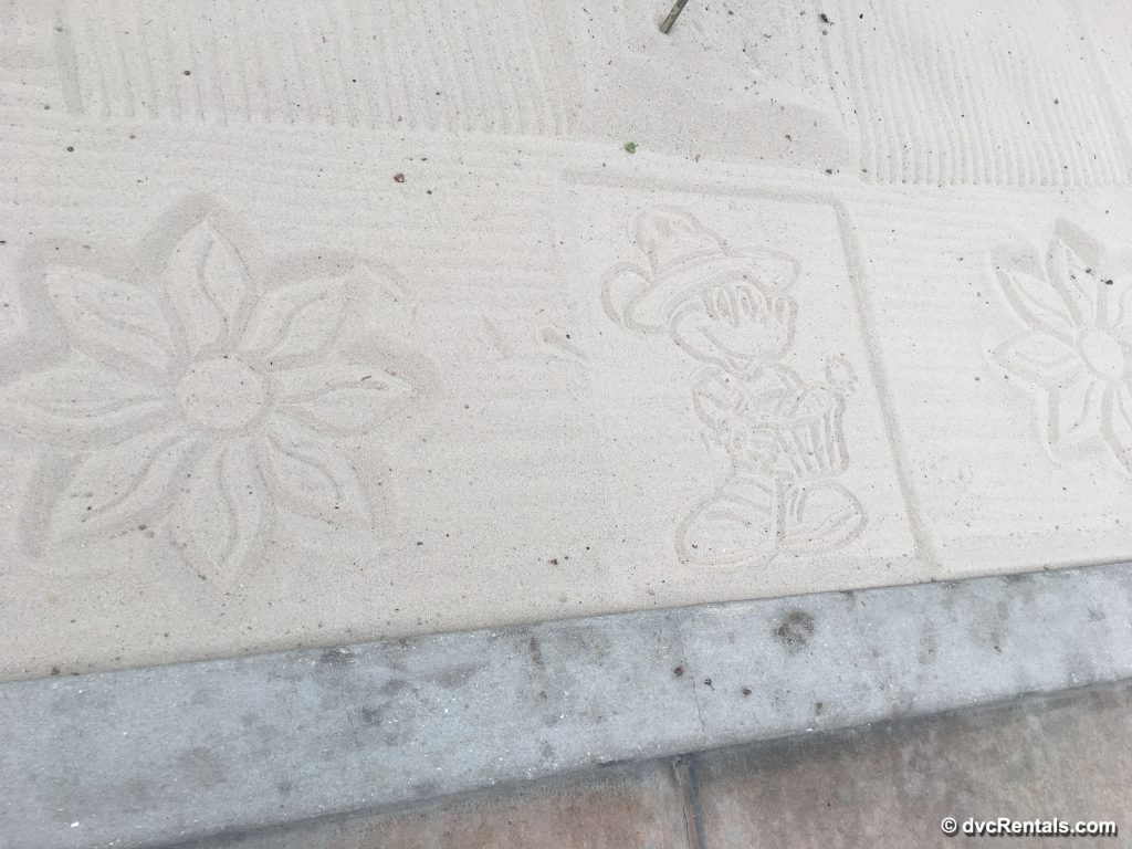 Disney art drawn in sand