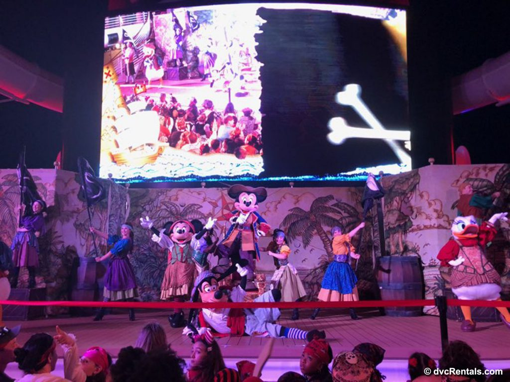 Characters dancing at the Pirates in the Caribbean party
