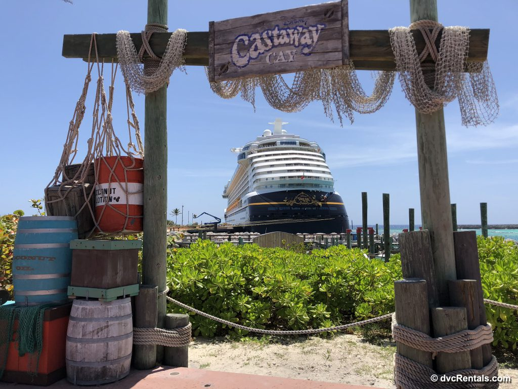 Disney Dream in the background of Castaway Cay sign