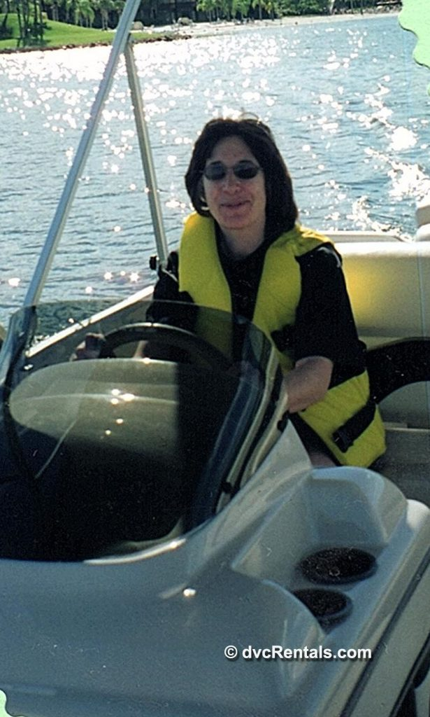 Team member Marilyn holding a fish she caught while on a boating excursion