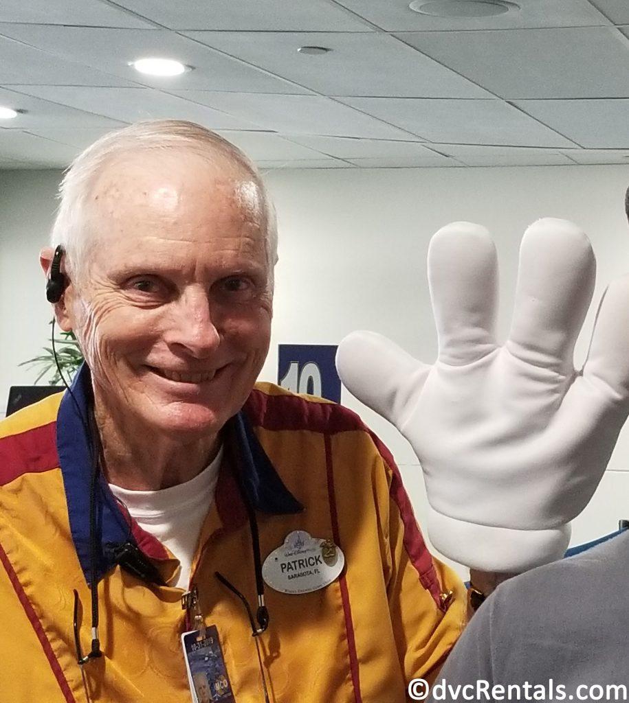 Disney Cast Member waving hello