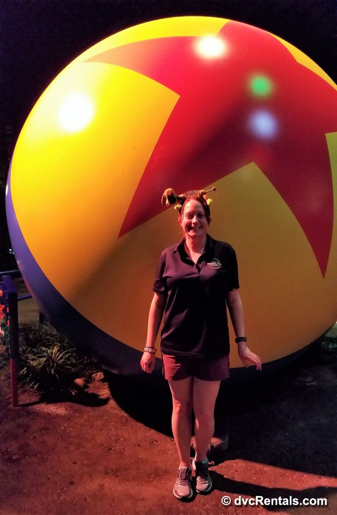 photo of team member Kelly next to the giant bouncy ball
