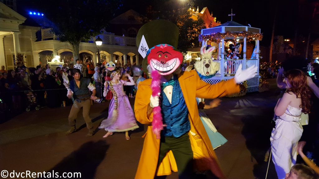 Mad Hatter dressed as the Cheshire Cat in the Boo To You Parade