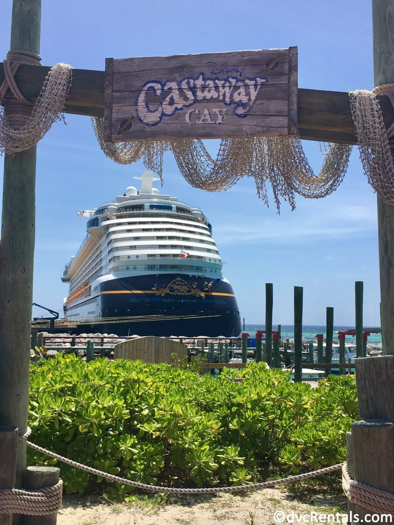 Castaway Cay sign with Disney Dream in the background