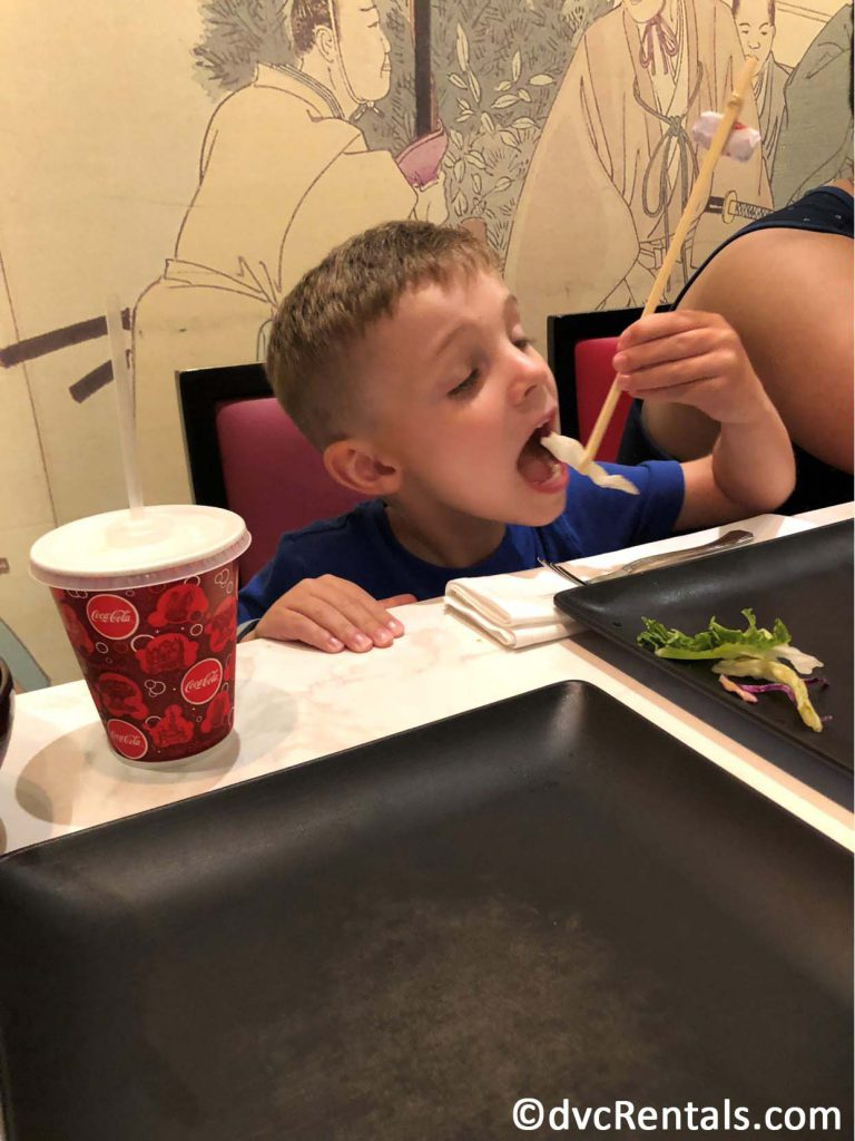 Young guest enjoying food from Teppan Edo Restaurant