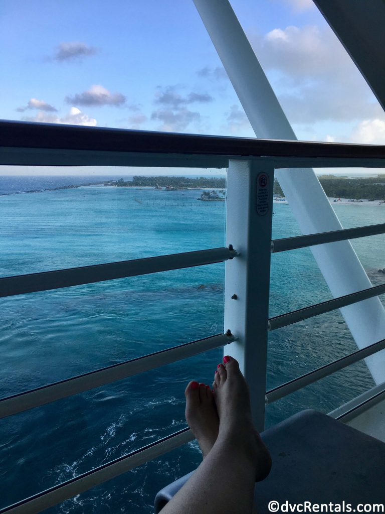team member Stacy sitting and relaxing with her feet up on her verandah on the Disney Dream
