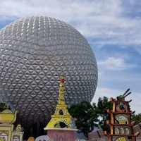 Entrance to Epcot with the International Food & Wine decorations and Geosphere in the background