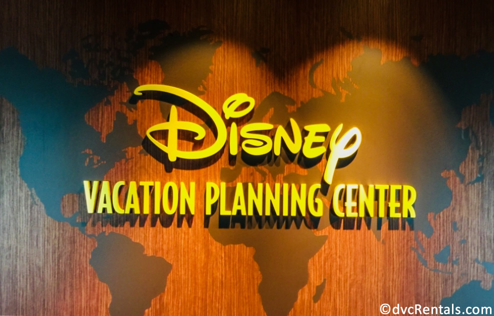 sign for the Disney Vacation Planning center on the Disney Dream