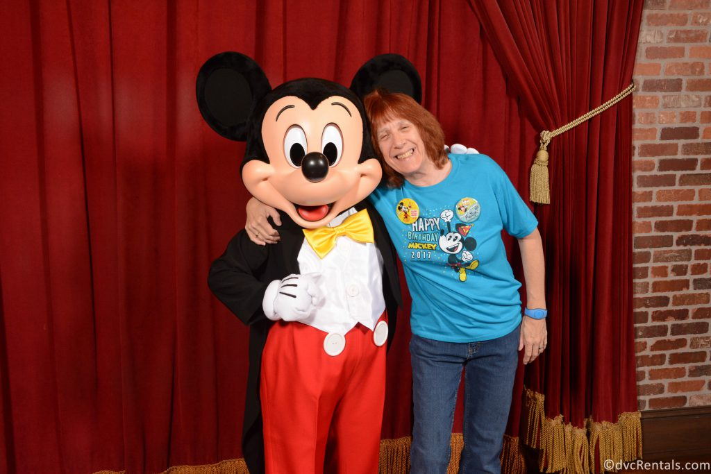 Marilyn posing for a picture with Mickey Mouse