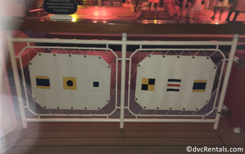 pool railing on the Disney Dream with use of nautical flags