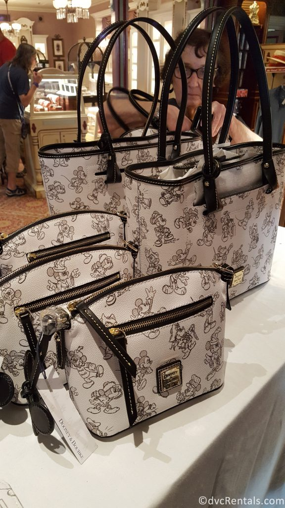 Mickey Mouse themed Dooney and Burke purses