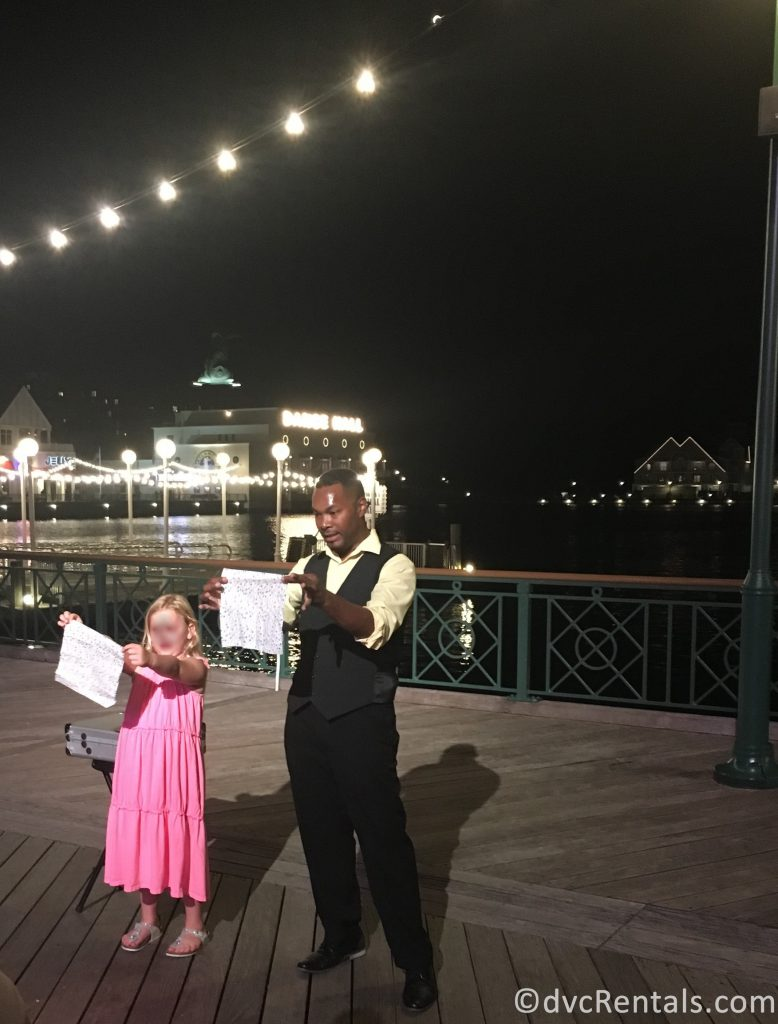 entertainer and guest performing on Disney Boardwalk