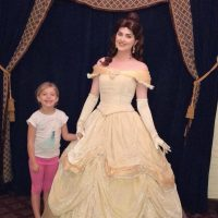 Belle and young guest posing for a picture at Akershus Royal Banquet Hall
