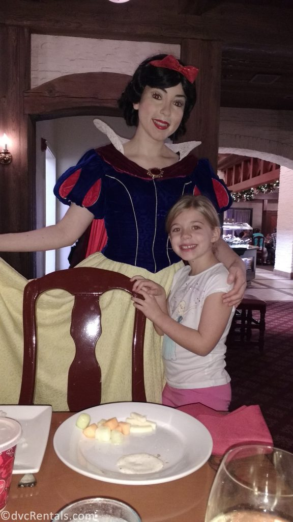 Snow White and young guest posing for a picture at Akershus Royal Banquet Hall