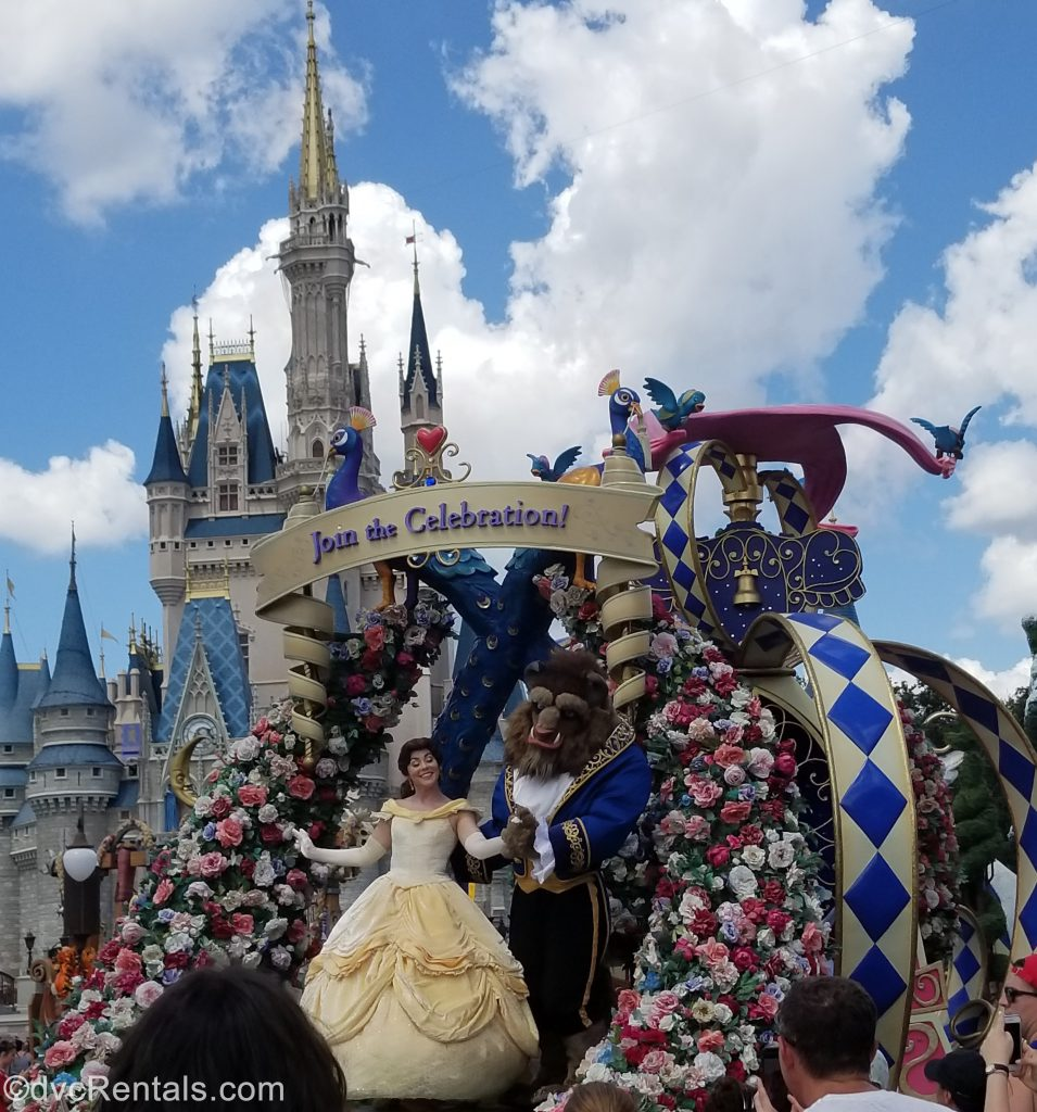 Beauty and the Beast on a float in front of Cinderella Castle