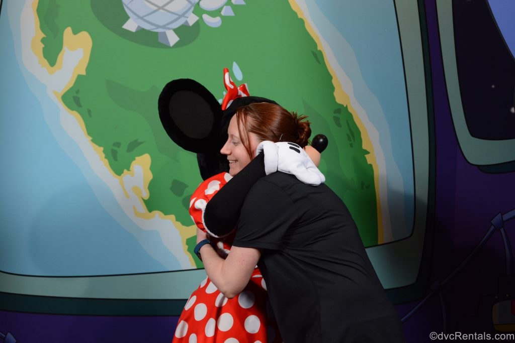 Team Member Kelly hugging Minnie Mouse
