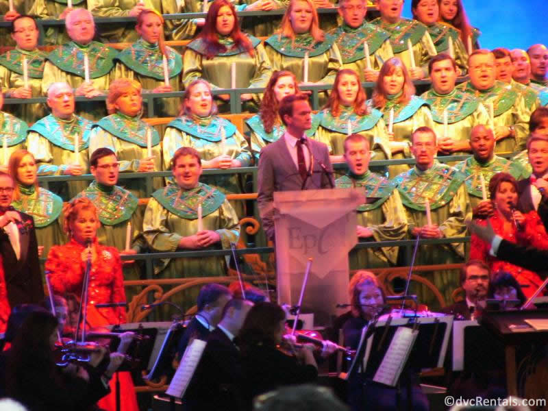 Voice of Liberty member performing in the choir for the Candlelight Processional