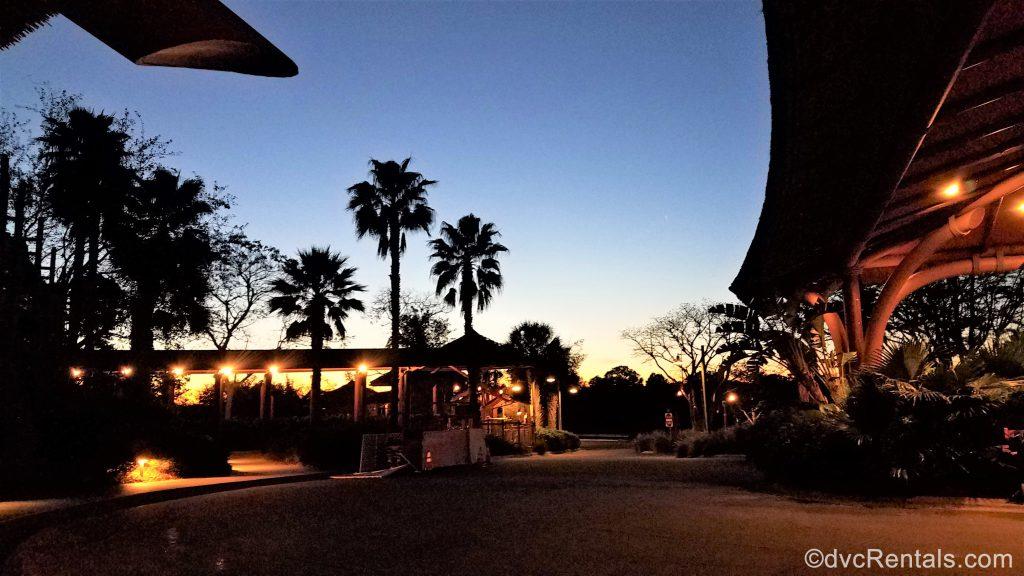 sunset over the entrance to Disney's Animal Kingdom – Kidani Village