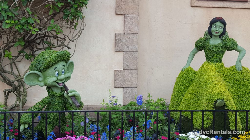 Snow White and Dopey topiaries at Epcot's International Flower and Garden Festival 2019