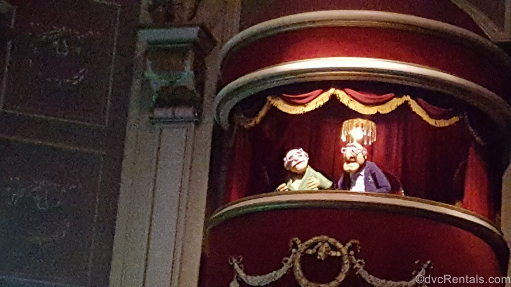 Statler and Waldorf sitting in theater seats at Muppet Theater