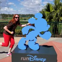 Team Member Kelly with the Run Disney Sign