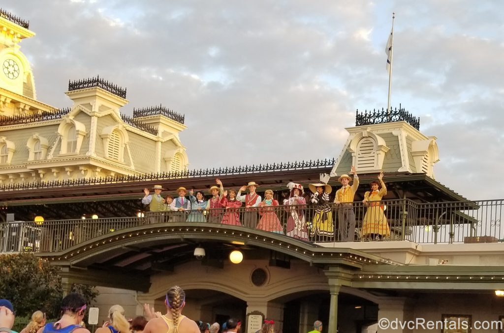 Citizens of Main Street U.S.A. greeting participants as they run through the Magic Kingdom