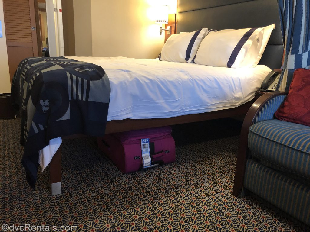 stateroom on the Disney Dream with suitcase under the bed