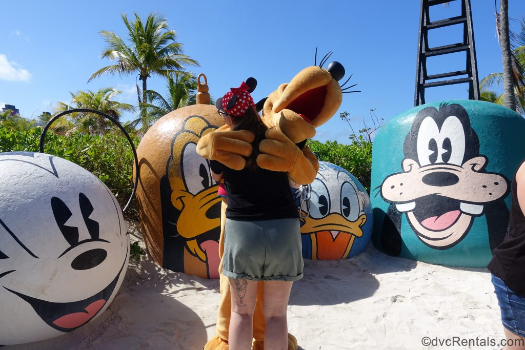 Pluto with Team Member Carly at Castaway Cay