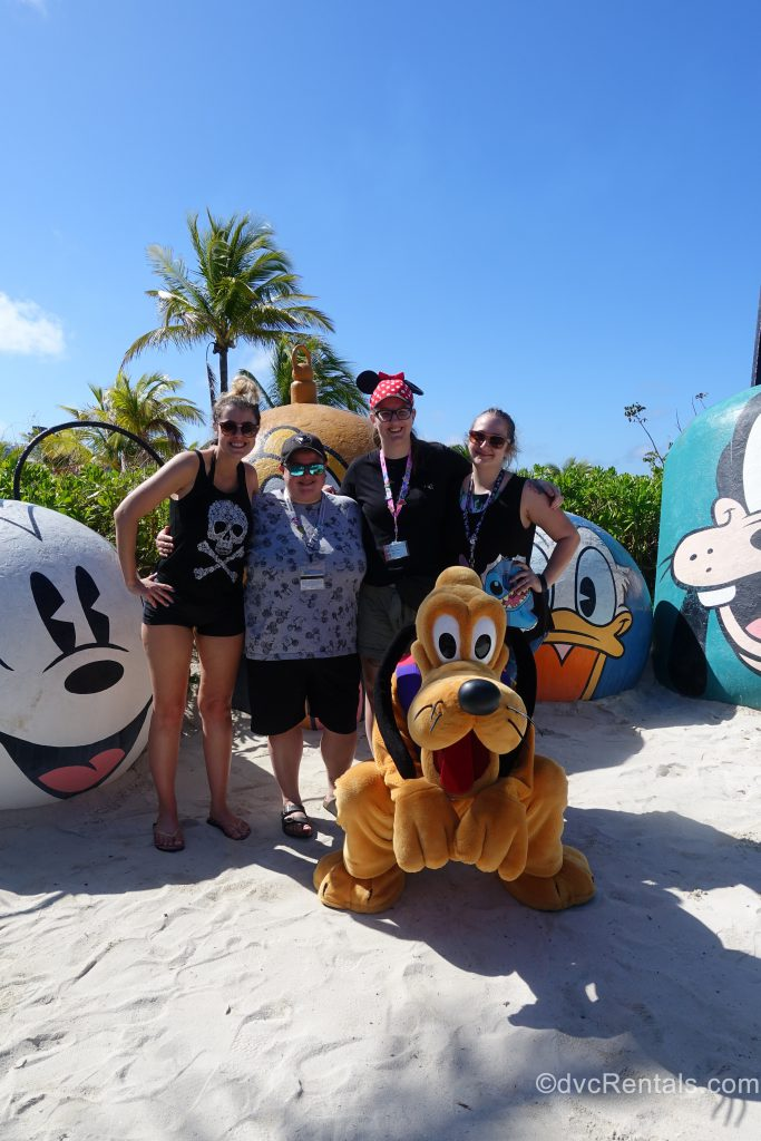 Pluto with Team Members Lindsay, Carly, Cassie and Stephanie S at Castaway Cay