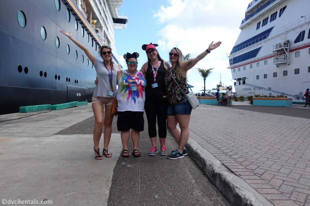Team Members Lindsay, Carly, Stephanie S. and Cassie standing next to the Disney Dream