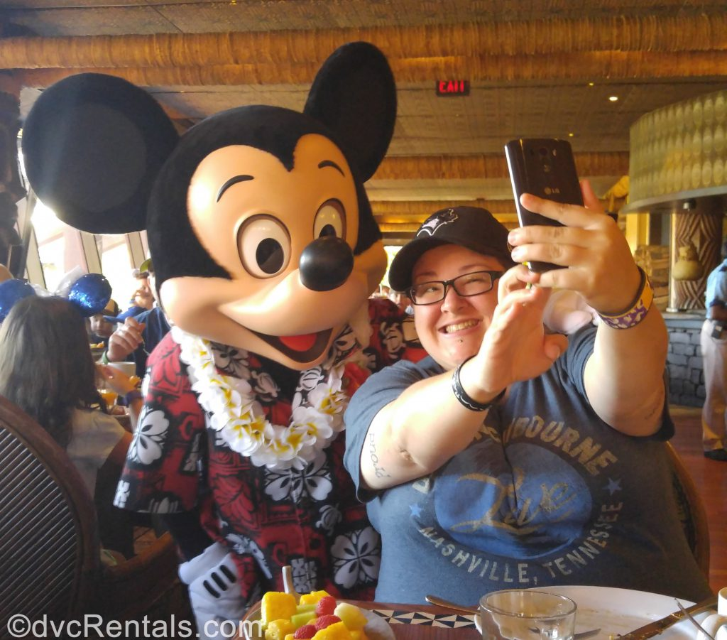 Team Member Lindsay posing for a picture with Mickey Mouse