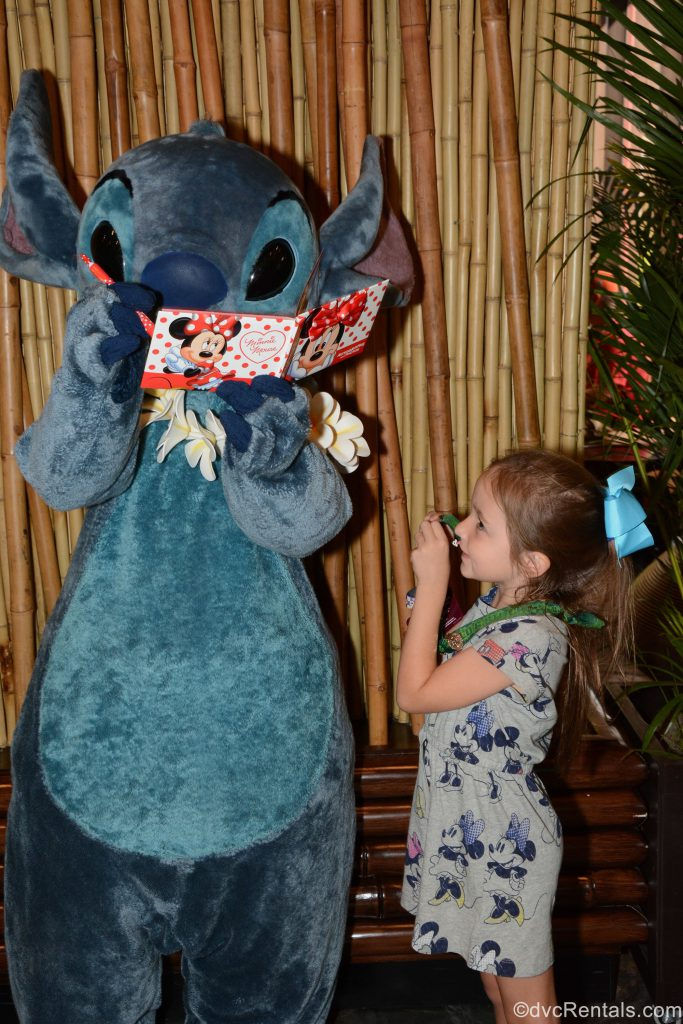 Guest posing for picture with Stitch