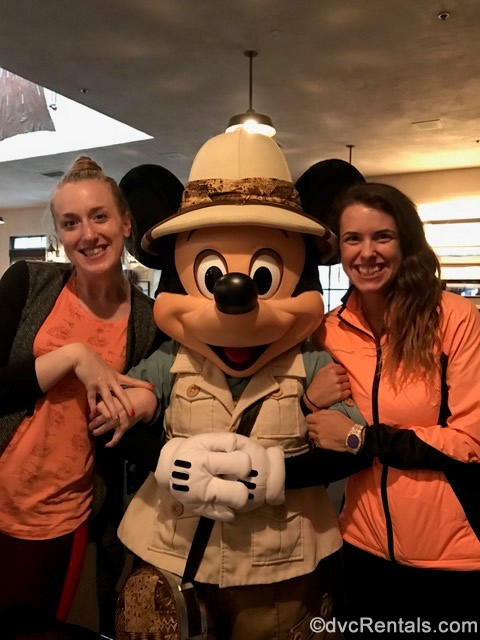 Team Members Chelsey and Stephanie S. posing for a picture with Mickey Mouse