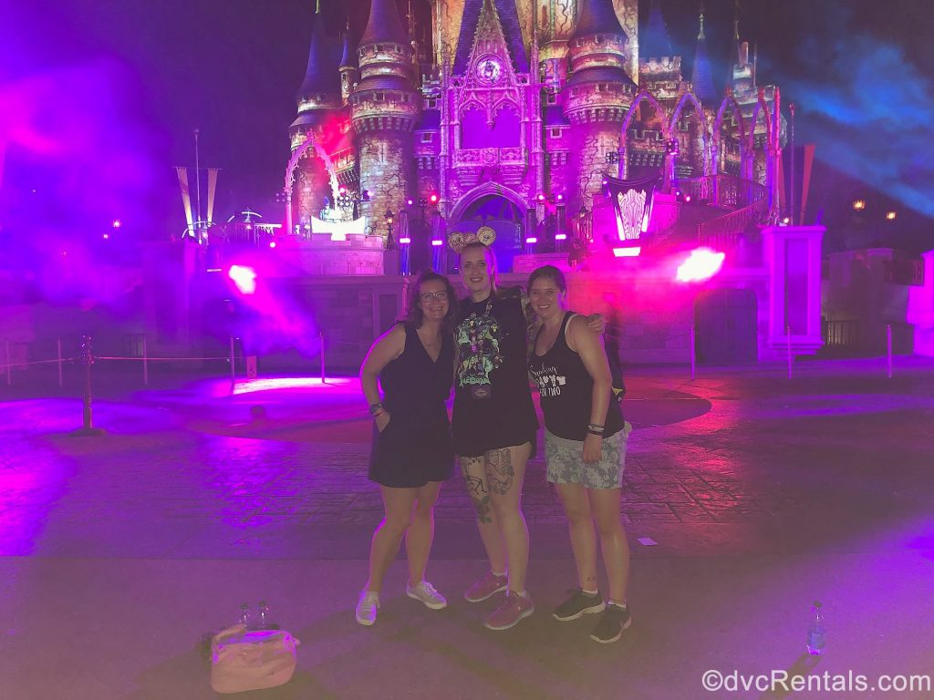 Team Members Melissa, Chelsey and Ashley J. in front of Cinderella Castle