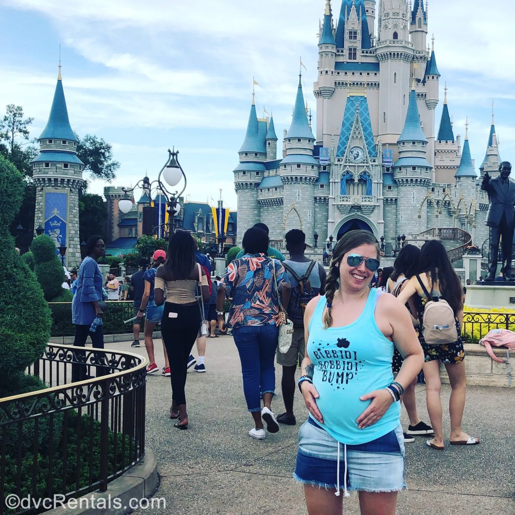 Team Member Ashley J. standing in front of Cinderella Castle
