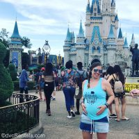 Team Member Ashley J. standing in front of Cinderella Castle