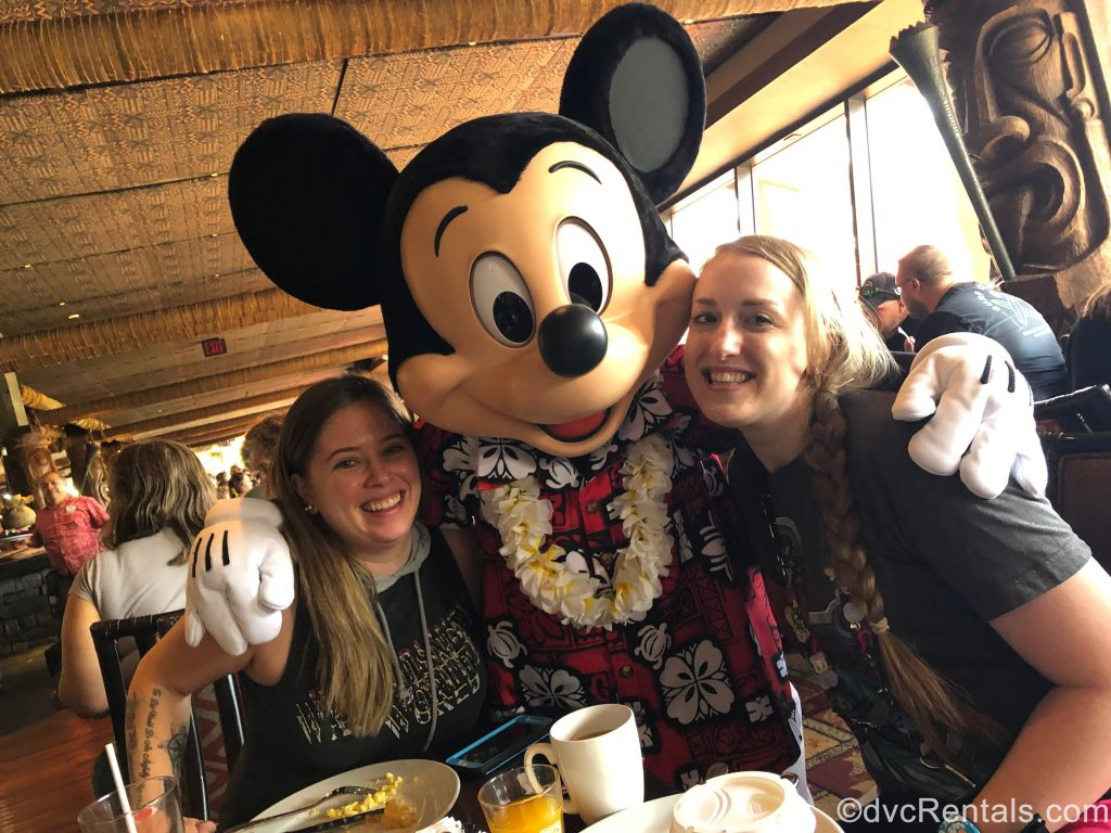 Team Members Ashley J. and Chelsey with Mickey Mouse at 'Ohana Restaurant