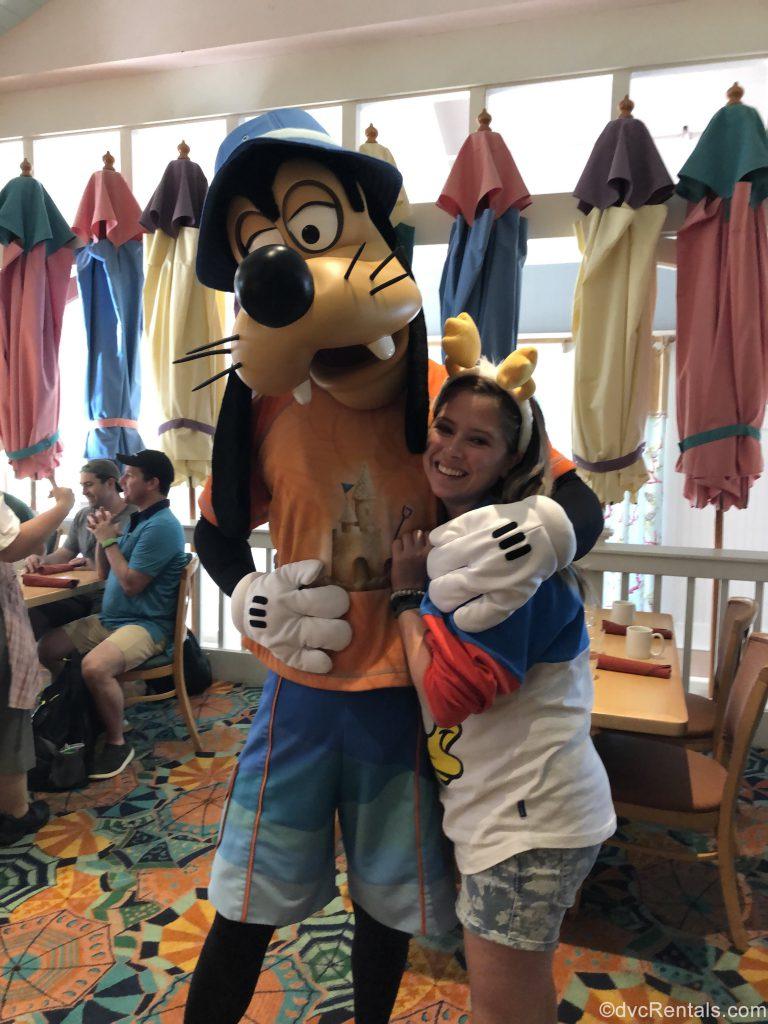 Team Member Ashley J. with Goofy at Cape May Café