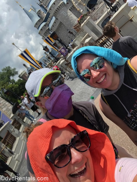 Team Member's Melissa, Ashley J. and Chelsey with cooling towels at WDW