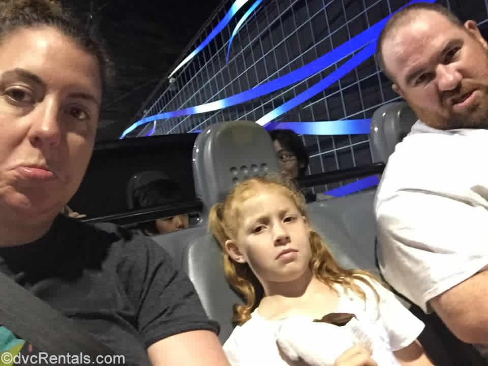 Guest Blogger meg with her family on Test Track in Epcot