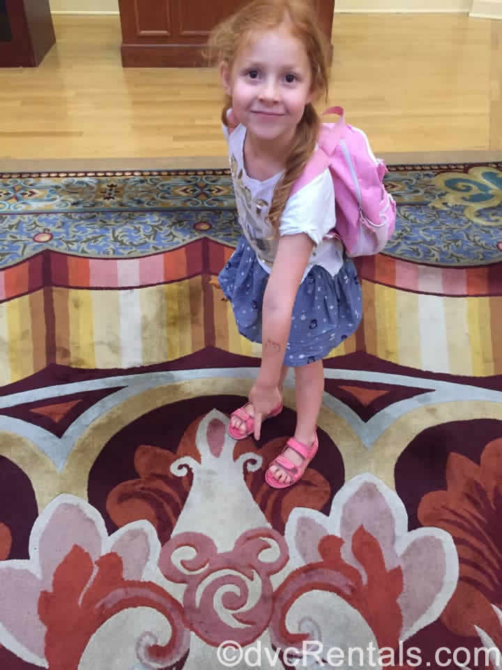 Guest Blogger's Meg's daughter pointing out a Hidden Mickey at WDW