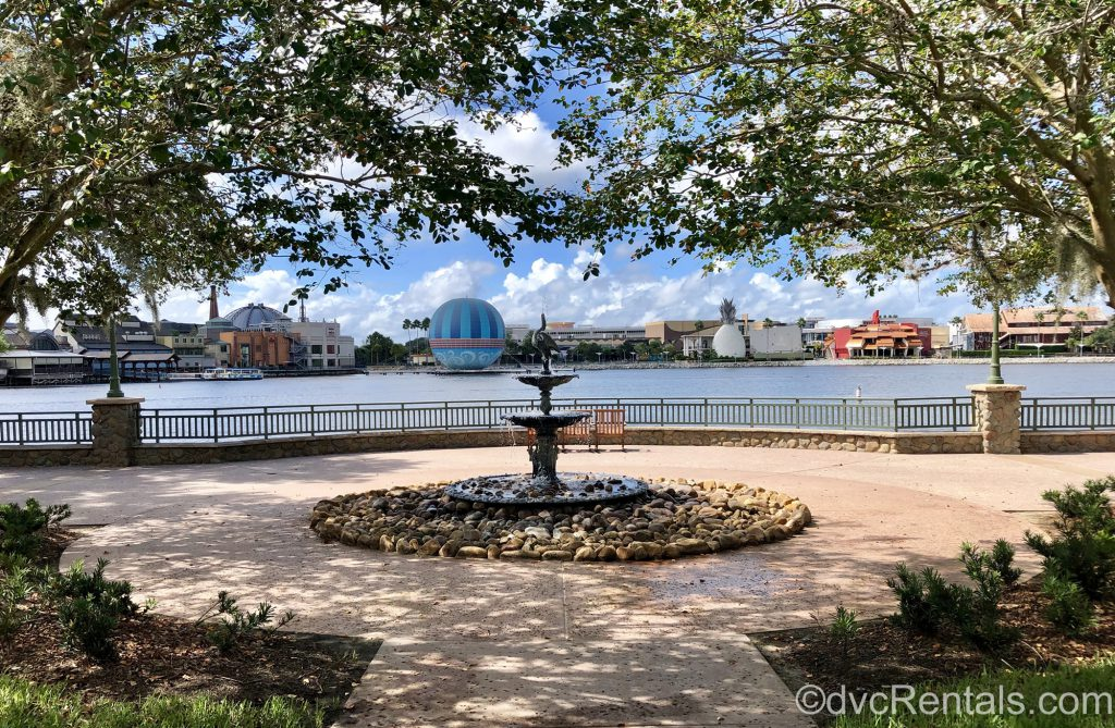 Fountain at Disney's Saratoga Springs Resort with Disney Springs in the background