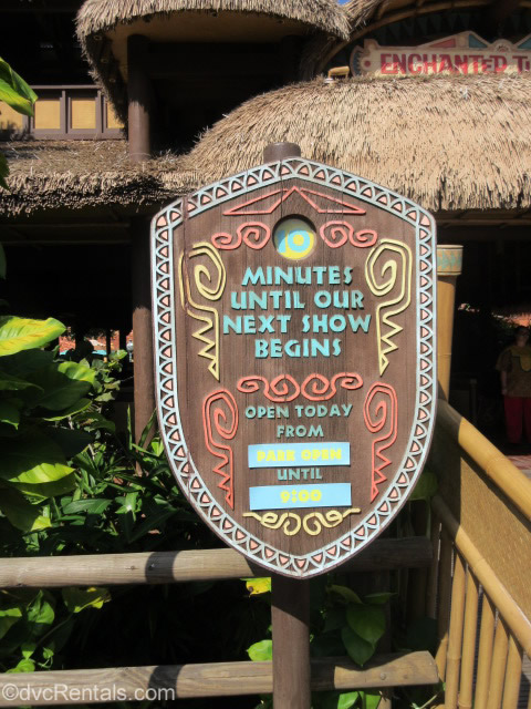 Tiki Room Sign with show times listed