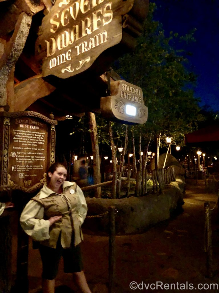 Disney Cast Member smiling outside of the 7 Dwarfs Mine Train