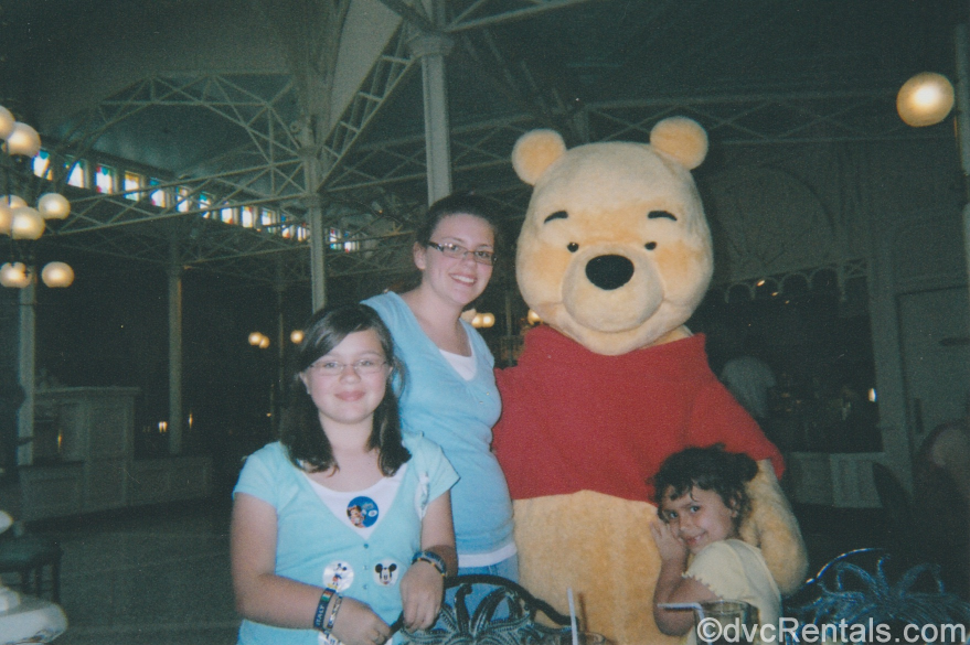 Team Member Alyssa and her family with Winnie the Pooh at Crystal Palace