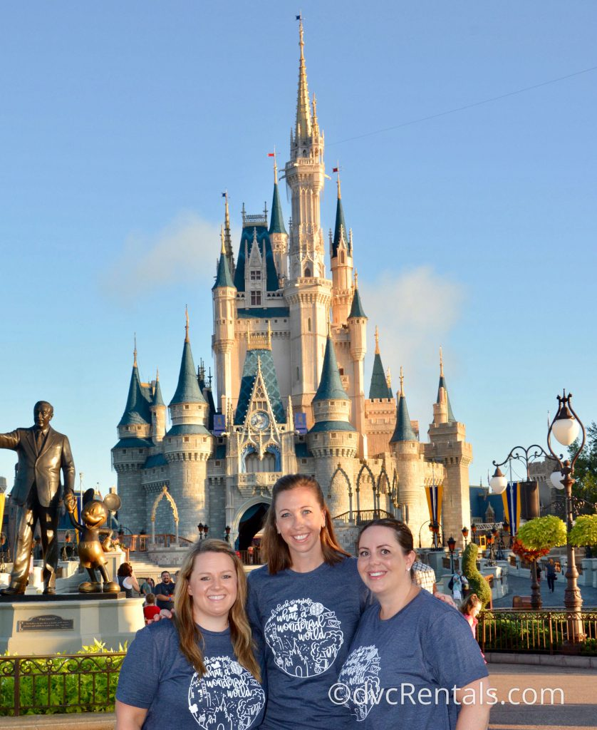 Team Member Stacy with her family in front of Cinderella Castle
