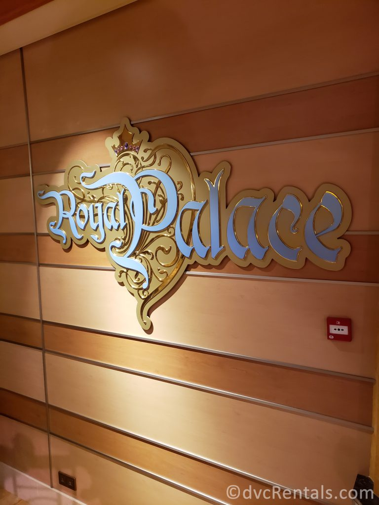 sign for the Royal Palace restaurant on the Disney Dream