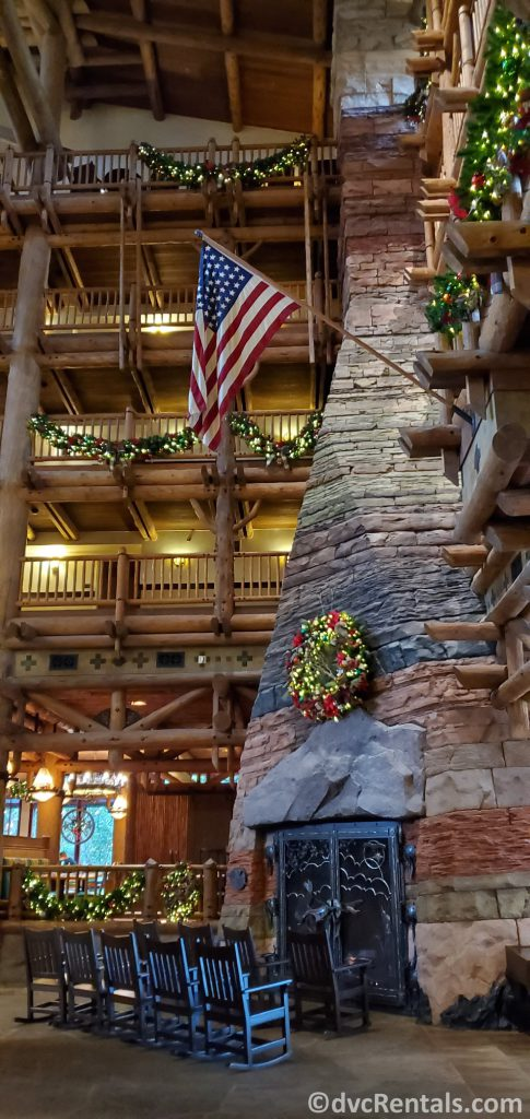 Christmas decorations around the lobby fireplace at Boulder Ridge Villas and Copper Creek Villas & Cabins at Disney's Wilderness Lodge